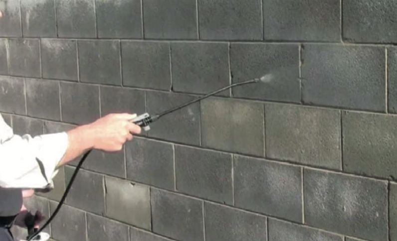 Applying protective coatings to a wall